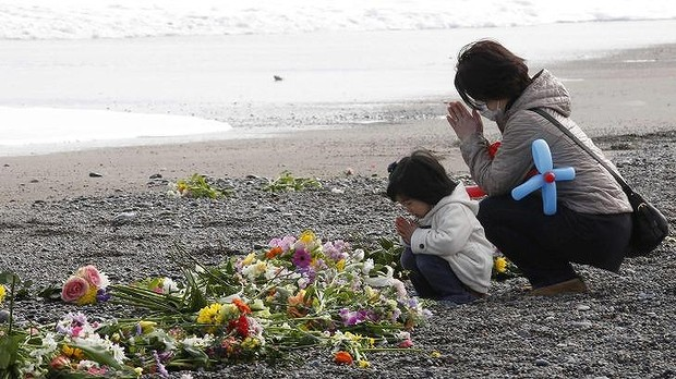 Paying respect at Fukushima, one year on: More than 18,000 people died when the tsunami hit. Photo: Reuters
